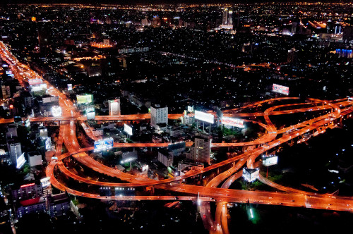 A view of one of the major expressway interchanges in Bangkok, Thailand. The system sees a traffic of over 1.5 million vehicles per day. A complex elevated expressway network helps bring traffic into and out of the city center, but Bangkok's rapid growth has put a large strain on infrastructure, and traffic jams have plagued the city since the 1990s. (Wikipedia / Photo: Mark Fischer)